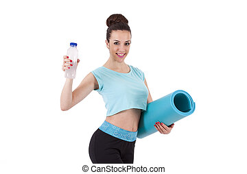 portrait of girl with mat and water bottle