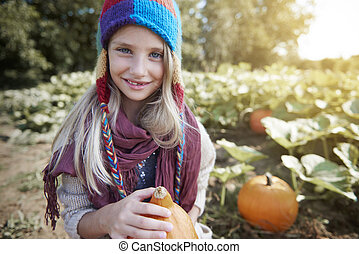 Portrait of girl with orange pumpkin
