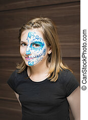 Portrait of girl with sugar skull make up