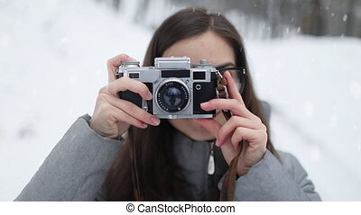 Portrait of Girl with Vintage Camera Taking Photographs -...