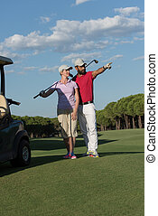 portrait of golfers couple on golf course