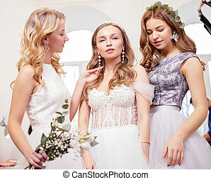 good-looking three women together in wedding dresses