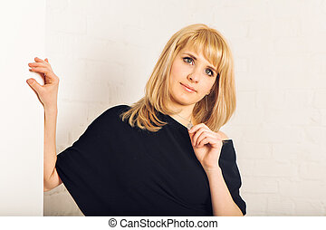 Portrait of gorgeous blonde woman in the room. Beauty, fashion.