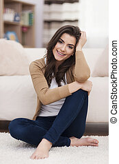 Portrait of gorgeous natural woman in living room