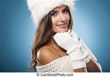 Portrait of gorgeous winter woman wearing fur hat