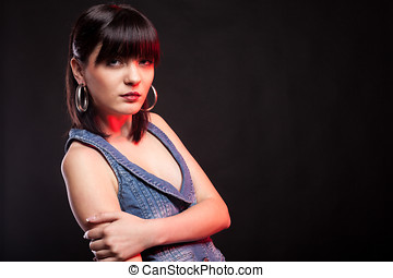 Portrait of gorgeous woman posing in fashion style