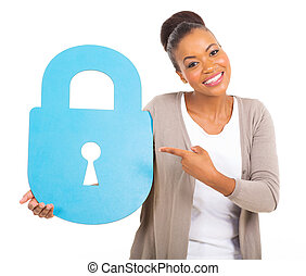 young african american woman pointing a large security lock...
