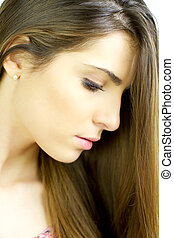 Portrait of gorgeous young woman with beautiful skin and hair