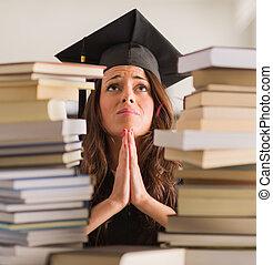 Portrait Of Graduated Woman Praying