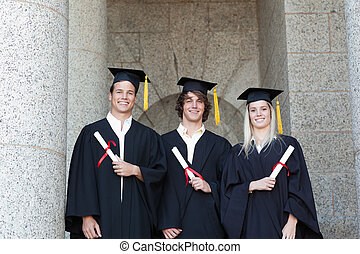 Portrait of graduates holding their diploma