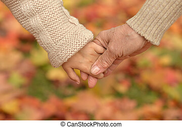 Portrait of granddaughter and grandmother holding hands