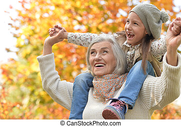 grandmother and granddaughter in park