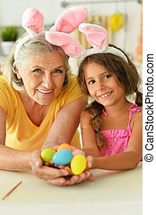 Portrait of grandmother and granddaughter with Easter eggs