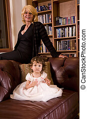 Portrait of grandmother and granddaughter at home