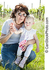 portrait of grandmother with her granddaughter