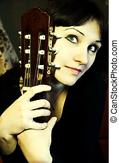 green-eyed girl with guitar