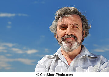 portrait of grey-haired senior outdoor, blue sky