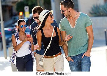 Portrait of group friends having fun in the street.