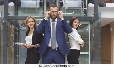 Portrait of group of business people in modern office building.