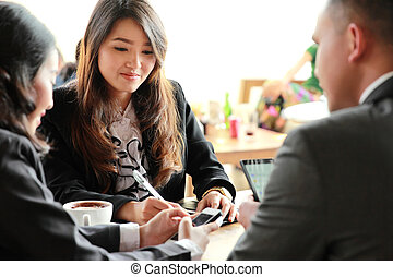 group of business people meeting at coffee shop