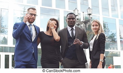 Portrait of group of happy and diverse business people who...