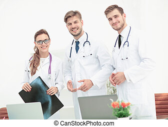 Portrait of group of smiling hospital colleagues standing togeth
