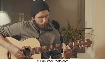 Portrait of guitarist playing a guitar. Medium shot 4K
