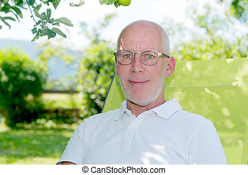 2b93f9fd60f6 Handsome 35 years old man with glasses outdoors.
