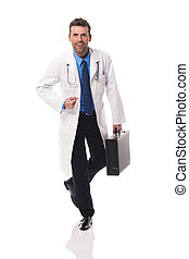 Portrait of handsome and confident male doctor