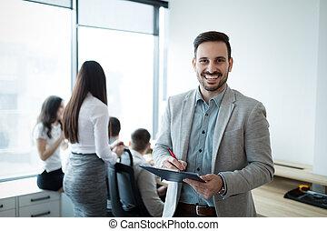 Portrait of handsome businessman in modern office