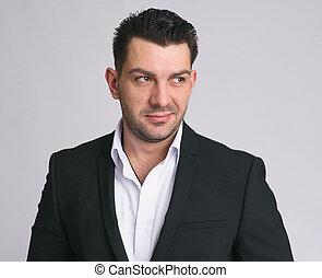 portrait of handsome businessman smirking