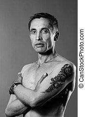 portrait of handsome caucasian man with body-art