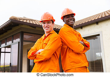 contractors standing in front of house