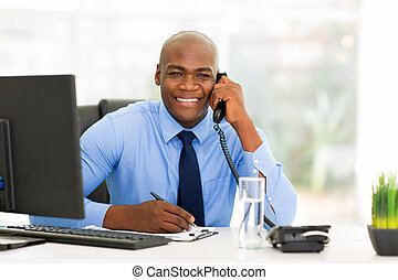 male african office worker talking on phone