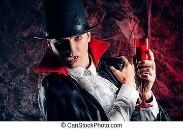 handsome man dressed in a Dracula costume for Halloween. - ...