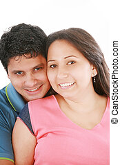 Portrait of handsome man hugging his wife from behind against white background