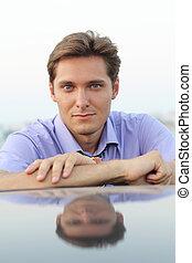 Portrait of Handsome Man smiling at camera
