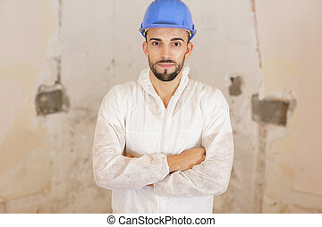 portrait of handsome man with arms crossed