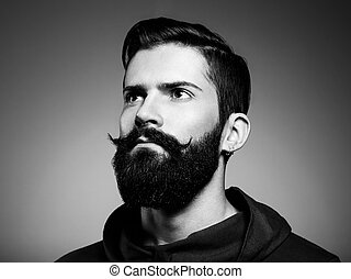 Portrait of handsome man with beard. Close-up. Black and white photo