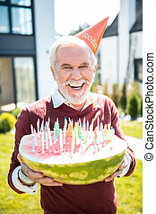 Portrait of handsome mature man that having birthday