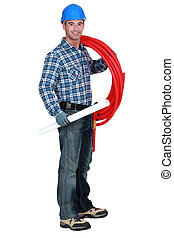 portrait of handsome plumber carrying red hose isolated on...