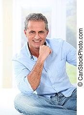 Portrait of handsome smiling mature man