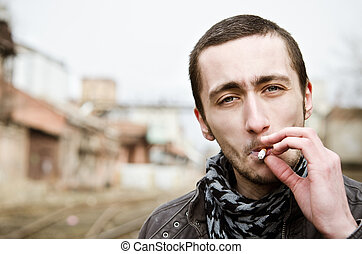Portrait of handsome smoking young man