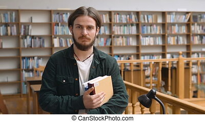 Portrait of Handsome Student in Library