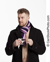 Portrait of handsome stylish blond man in sunglasses and a coat over her naked body in a beautiful stylish scarf