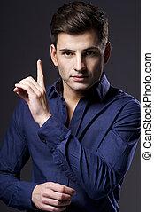 Portrait of handsome stylish man in elegant shirt