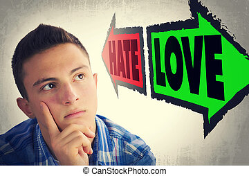 Portrait of handsome teenager faced with choice between HATE...
