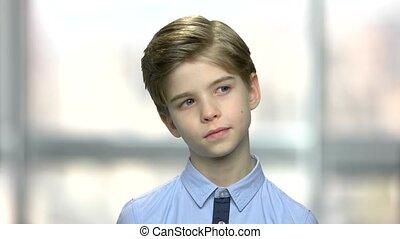 Portrait of handsome thinking little boy.