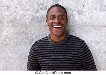 handsome young african american man laughing