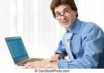 handsome young business man with laptop